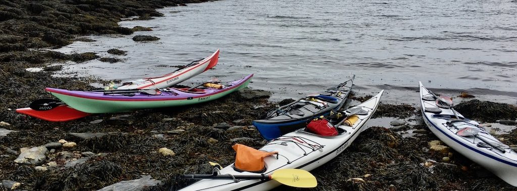 Nigel Dennis Kayaks on a rocky beach