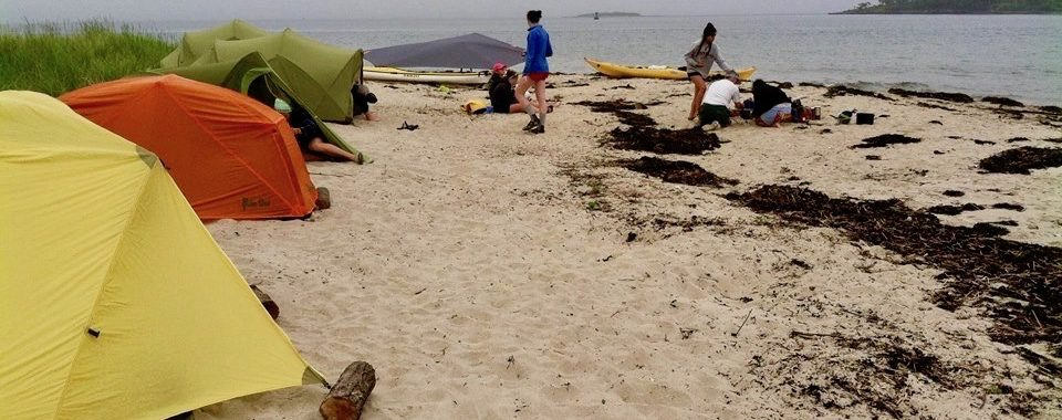 sea kayak camping on a beach