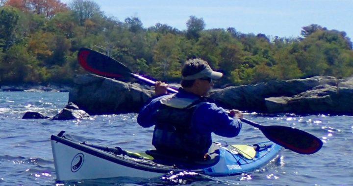 Tom Bergh paddling a Tiderace Kayak