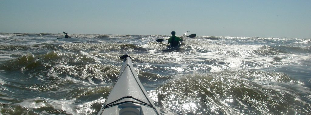 sea kayakers in rough water