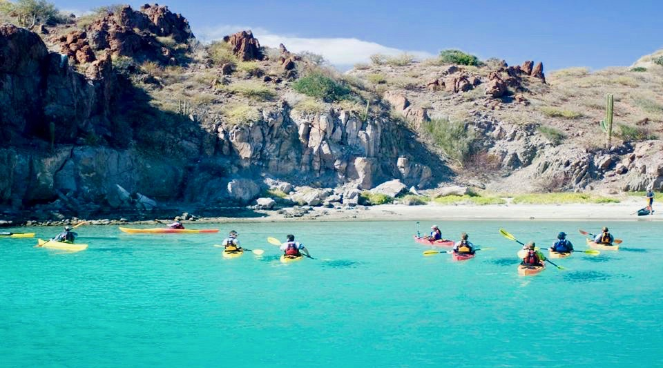 sea kayaks in a cove in Baja