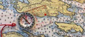 nautical chart and handheld compass