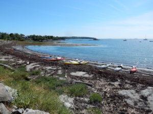 sea kayaks on Maine island beach