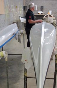 Nigel Dennis inspecting new kayaks in the factory