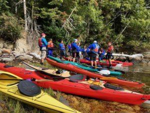 geology students and sea kayaks