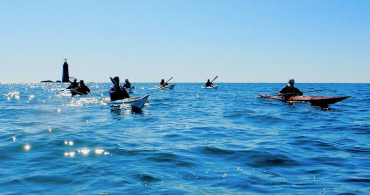 Sea kayaking coaches paddling back from Ram Light in Casco Bay